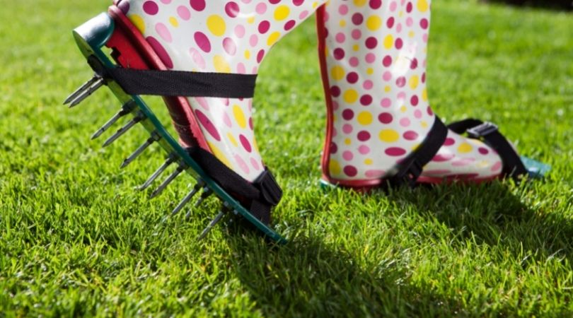 Boots with spikes for lawn aeration